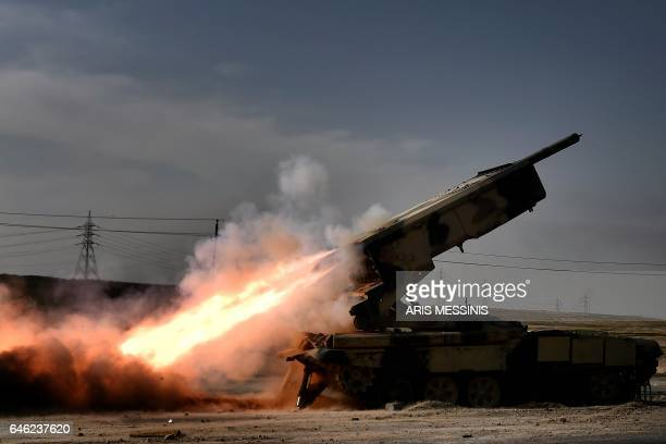 Iraqi troops fire a missile towards Islamic State group fighters from the outskirts of Mosul as Iraqi forces battle against the group to recapture...