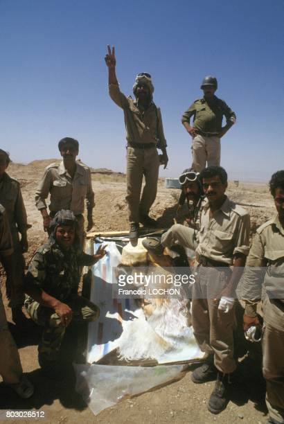 Iraqi troops holding portrait of Khomeini in Zubeidat area the day of cease fire on July 19 1988 in Iraq