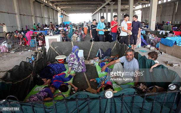 Iraqi Turkmen families fleeing Tel Afar at a camp in Arbil Iraq July 13 2014 Three construction material storage areas belong to Kurdish Regional...