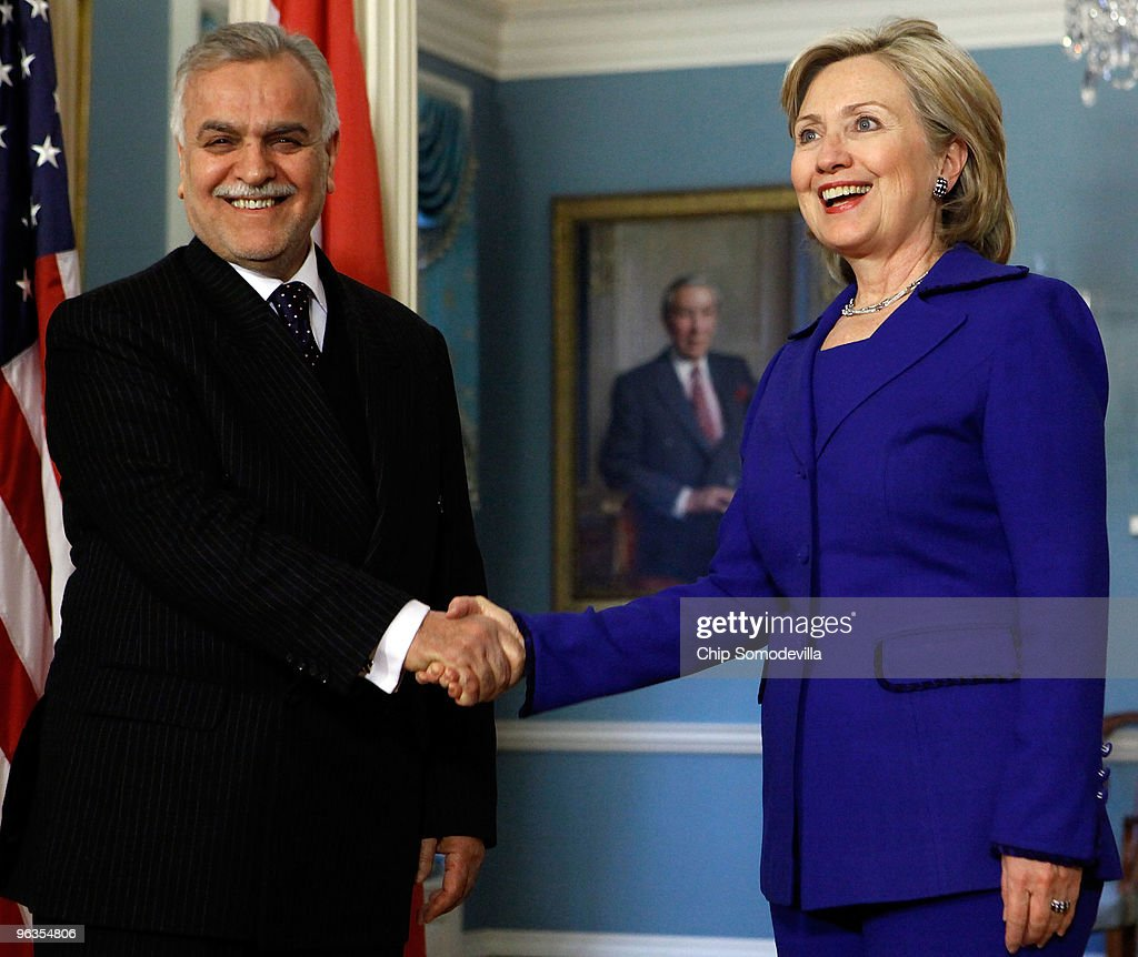 Iraqi Vice President Dr. Tariq Hashimi (L) shakes hands with U.S. Secretary of State <a gi-track='captionPersonalityLinkClicked' href=/galleries/search?phrase=Hillary+Clinton&family=editorial&specificpeople=76480 ng-click='$event.stopPropagation()'>Hillary Clinton</a> at the State Department February 2, 2010 in Washington, DC. Hashimi met earlier with President Barack Obama and Vice President Joe Biden and they discussed Iraq's upcoming general elections scheduled for March and the United States planned withdrawal in 2011.