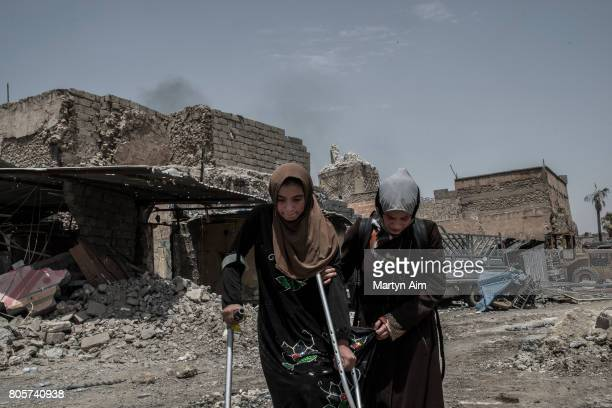Iraqi women flee the Old City district where heavy fighting continues July 2 2017 in Mosul Iraq Iraqi forces continue to encounter stiff resistance...