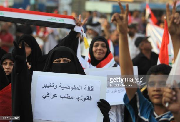 Iraqi women followers of cleric Moqtada alSadr take part in a demonstration against corruption in Iraq and demanding reform and a change in the...
