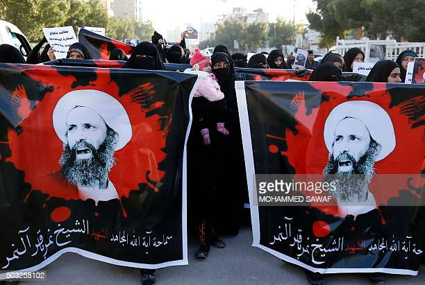 Iraqi women hold portraits of prominent Shiite cleric Nimr alNimr during a demonstration against against his execution by Saudi Arabian authorities...