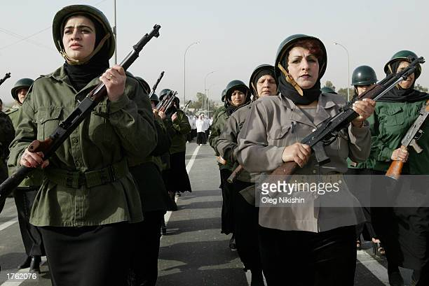 Iraqi Women march during a parade in Mosul north of Baghdad February 4 2003 Thousands of armed volunteers paraded in northern Iraq in defiance of US...