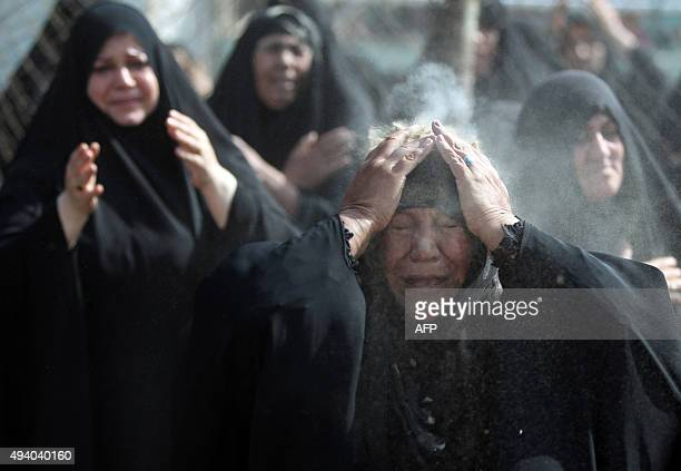 Iraqi women mourn during the reenactment of the Battle of Karbala on the tenth day of the mourning period of Muharram which marks the day of Ashura...