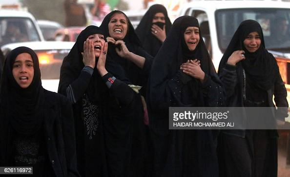 Iraqi women mourn in the southern city of Basra on November 27 2016 during the funeral of four fighters from the Hashed alShaabi paramilitaries who...