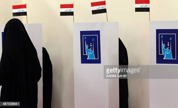 Iraqi women residing in the UAE cast their ballot for Iraq's parliamentary elections at a polling station in Dubai on April 27 2014 Iraqi expats head...