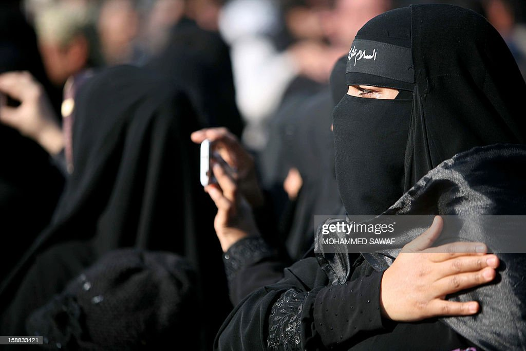 Iraqi women take part in the Arbaeen religious festival which marks the 40th day after Ashura commemorating the seventh century killing of Prophet Mohammed's grandson, Imam Hussein, in the shrine city of Karbala, southwest of Iraq's capital Baghdad, on December 31, 2012. A wave of bombings and shootings killed 12 people as Iraq grappled with anti-government protests and simmering political crises ahead of major Shiite Muslim commemoration rituals. AFP PHOTO/MOHAMMED SAWAF