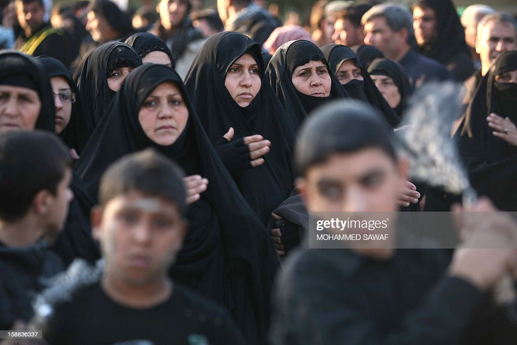 Iraqi women take part in the Arbaeen religious festival which marks the 40th day after Ashura commemorating the seventh century killing of Prophet Mohammed's grandson, Imam Hussein, in the shrine city of Karbala, southwest of Iraq's capital Baghdad, on December 31, 2012. A wave of bombings and shootings killed 12 people as Iraq grappled with anti-government protests and simmering political crises ahead of major Shiite Muslim commemoration rituals.