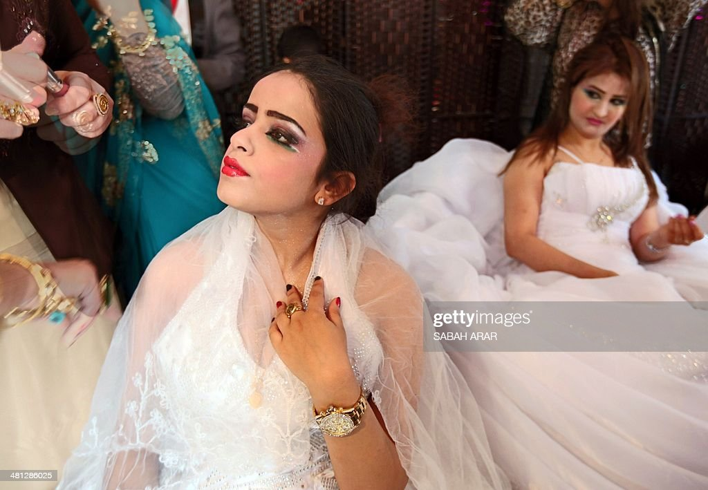 Iraqi women take part in the first beauty contest hosted by 'Ghassan Life Cosmetics' company for both male and female competitors in Baghdad on March 29, 2014. More than 40 men and 120 women participated in the competition from all over Iraq.