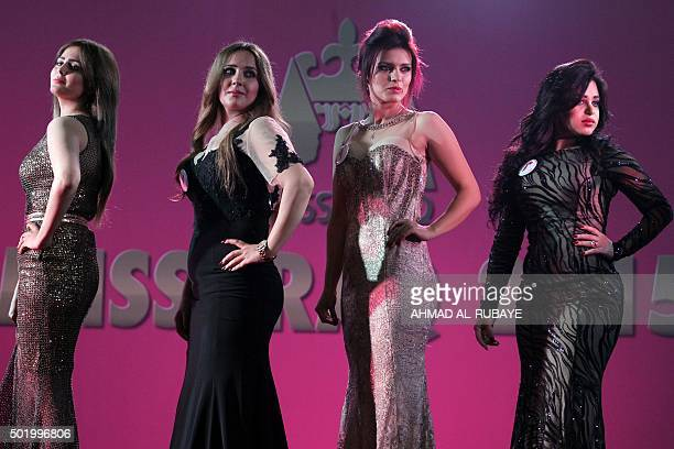 Iraqi women taking part in the Miss Iraq beauty contest pose on stage on December 19 2015 in the capital Baghdad The beauty contest is the first one...