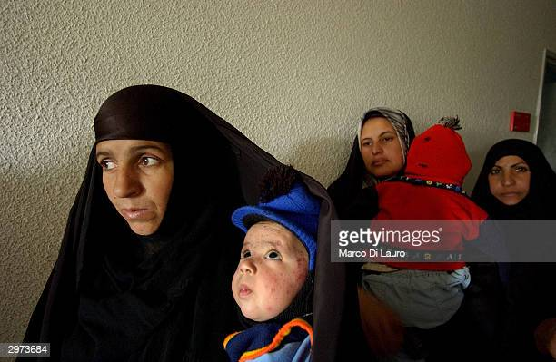 Iraqi women wait in line to have their children examined at the Samawa Maternity and Children Hospital 170 miles south of Baghdad February 12 2004 in...
