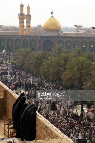 Iraqi women watch as crowds of Muslim Shias make a religious pilgrimage by walking to and around the mosques of Imam Abbas and Imam Hussein April 21...