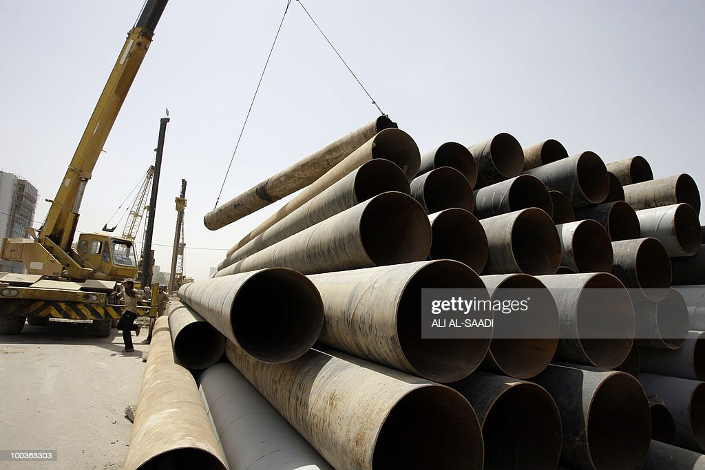 Iraqi workers prepare for the construction of a small bridge in central Baghdad on May 24, 2010, as Prime Minister Nuri al-Maliki invited during a press conference international investment companies to invest in Iraq.