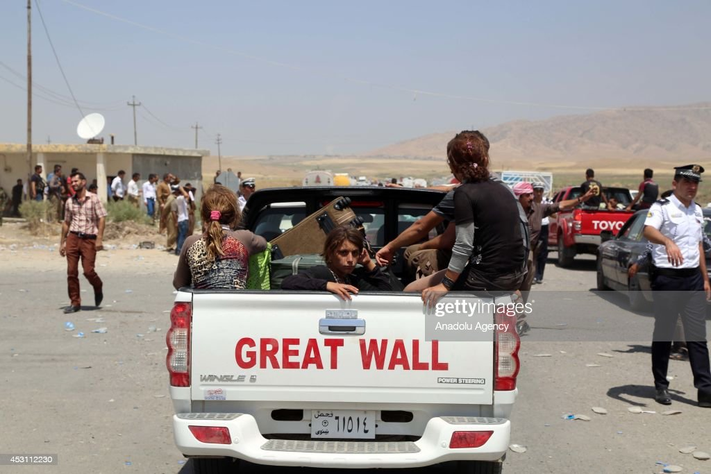 Iraqi Yazidis flee from Sinjar due to attacks of army groups led by Islamic State in Zakho district of Dohuk on August 3, 2014. Peshmergas check the passing of Yazidi families in Sihela Bridge away from Zakho 40 kilometers.