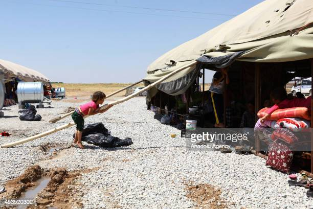 Iraqi Yezidi refugees escaping from attacks of Islamic State try to hold on life in Sirnak city of Turkey on August 12 2014 Iraqi Yezidi people fled...