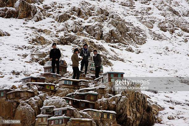Iraqi youth play with snow in the northern city of Sulaimaniyah on January 10 2013 Abnormal storms which have blasted the Middle East with rain snow...