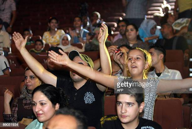 Iraqi youths attend a concert for Iraqi rap group DKZ at the national theatre in central Baghdad on July 10 2009 Around 150 fans attended the first...
