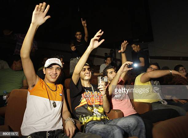 Iraqi youths attend a concert for the Iraqi rap group DKZ at the national theatre in central Baghdad on July 10 2009 Around 150 fans attended the...