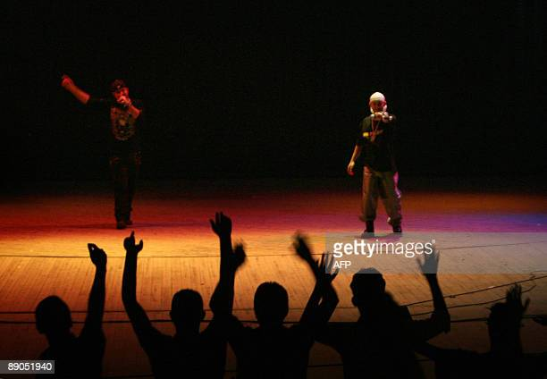 Iraqi youths cheer for the Iraqi rap group DKZ at the national theatre in central Baghdad on July 10 2009 Around 150 fans attended the first major...