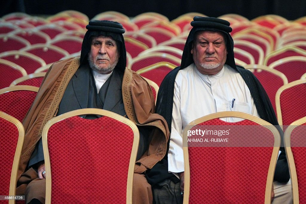 Iraqis attend a conference gathering Shiite and Sunni tribal leaders and clerics on November 8 2014 in the capital Baghdad to discuss a support to...