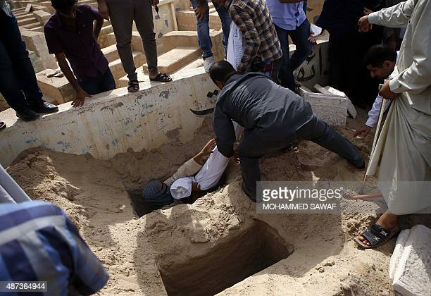 Iraqis bury the bodies of eightyearold boy Haidar and his 12yearold sister Zainab who drowned in a boat accident off the coast of Turkey during their...