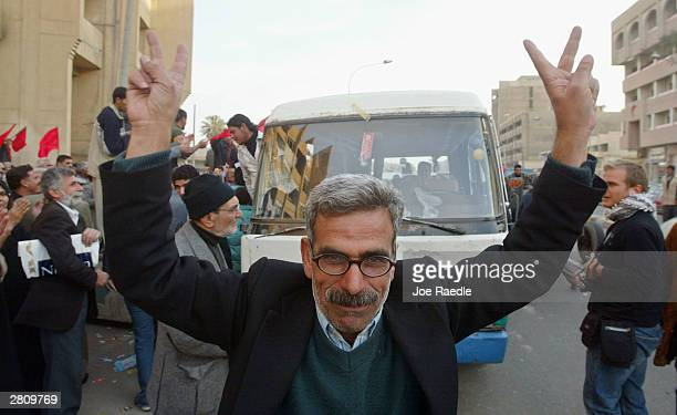 Iraqis Celebrate Capture Of Saddam Hussein