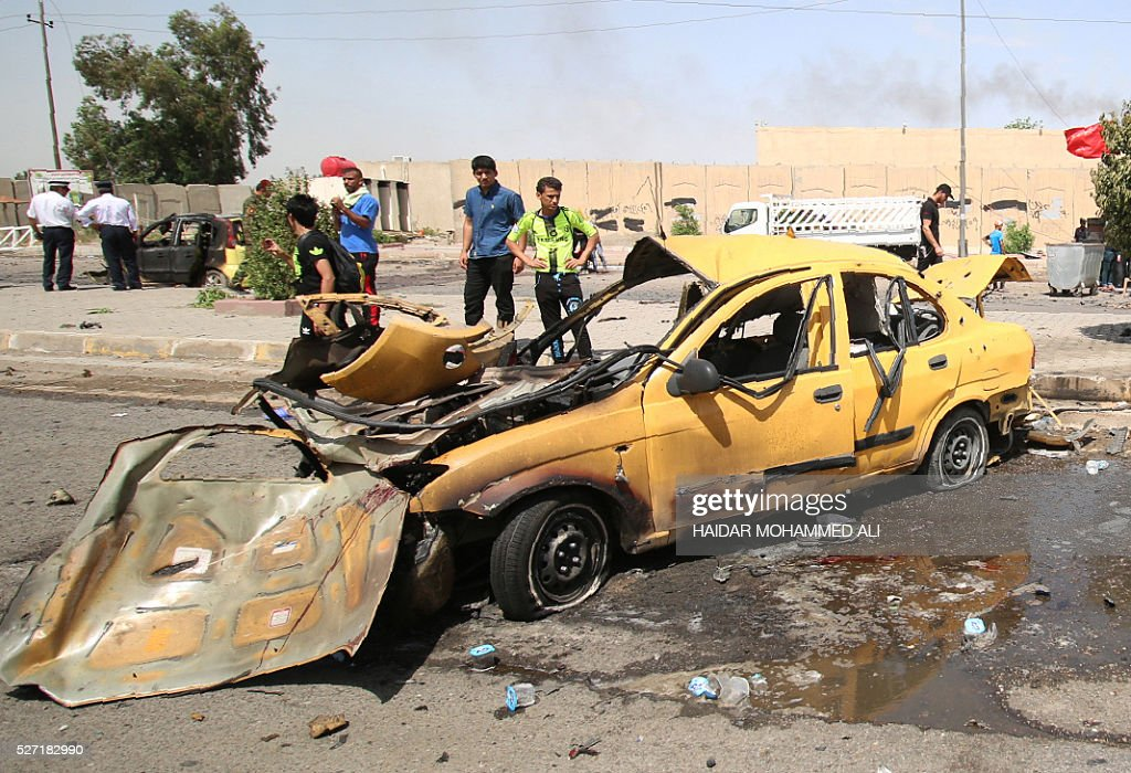 Iraqis check the damage following a car bomb targeting pilgrims heading to commemorate the death of Imam al-Kadhim in Baghdad's southern Saidiya neighbourhood on May 2, 2106. Many of the main thoroughfares in the ca[ital are closed in the days leading up to the annual commemoration of Imam Musa Kadhim's death, an important date in the Shiite Muslim calendar. ALI