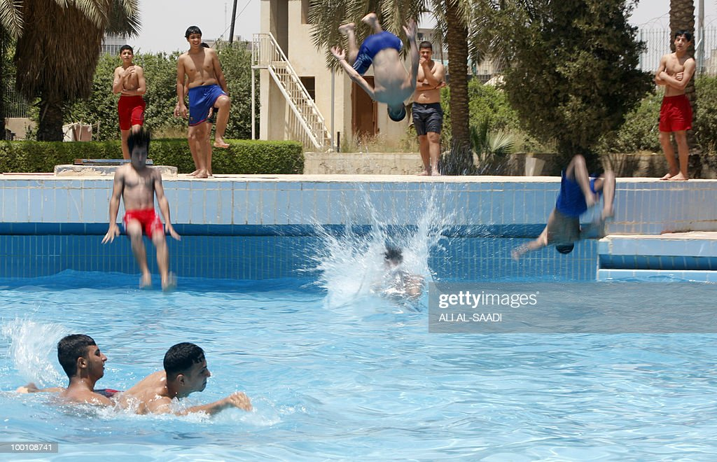 Iraqis cool off in a pool in Baghdad on May 21, 2010, as scorching summer sets in and electricity supplies falter.