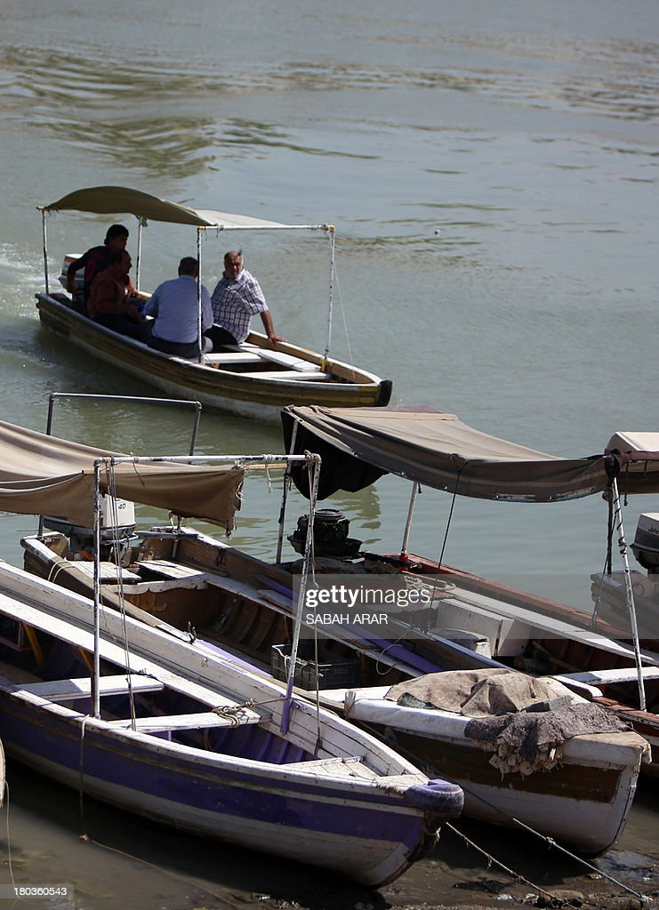 Iraqis cross the Tigris River which flows through the Iraqi capital of Baghdad on September 11 2013 Faced with a surge in attacks including a summer...