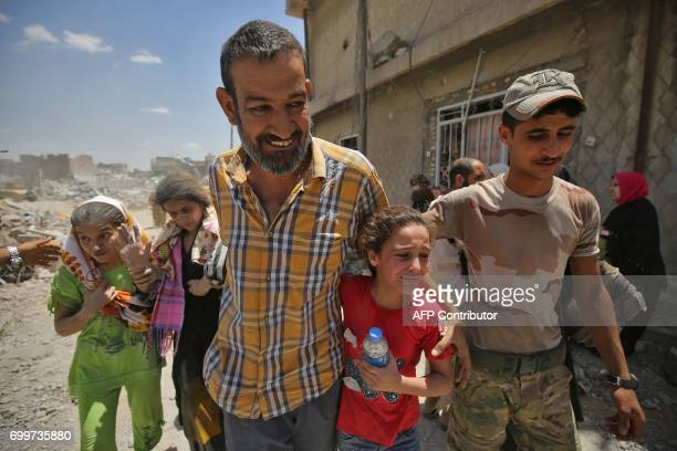 TOPSHOT Iraqis flee from the Old City of Mosul on June 22 during the ongoing offensive by Iraqi forces to retake the last district still held by the...