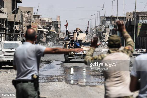 TOPSHOT Iraqis fleeing the Old City of Mosul arrive to the industrial district of the city on June 23 2017 as they flee the fighting between Iraqi...