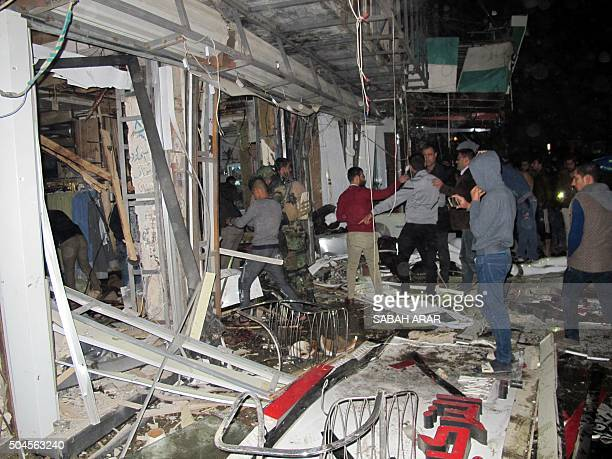 Iraqis gather at the site of an attack in eastern Baghdad on January 11 2016 Islamic State group claimed responsibility for an attack in eastern...