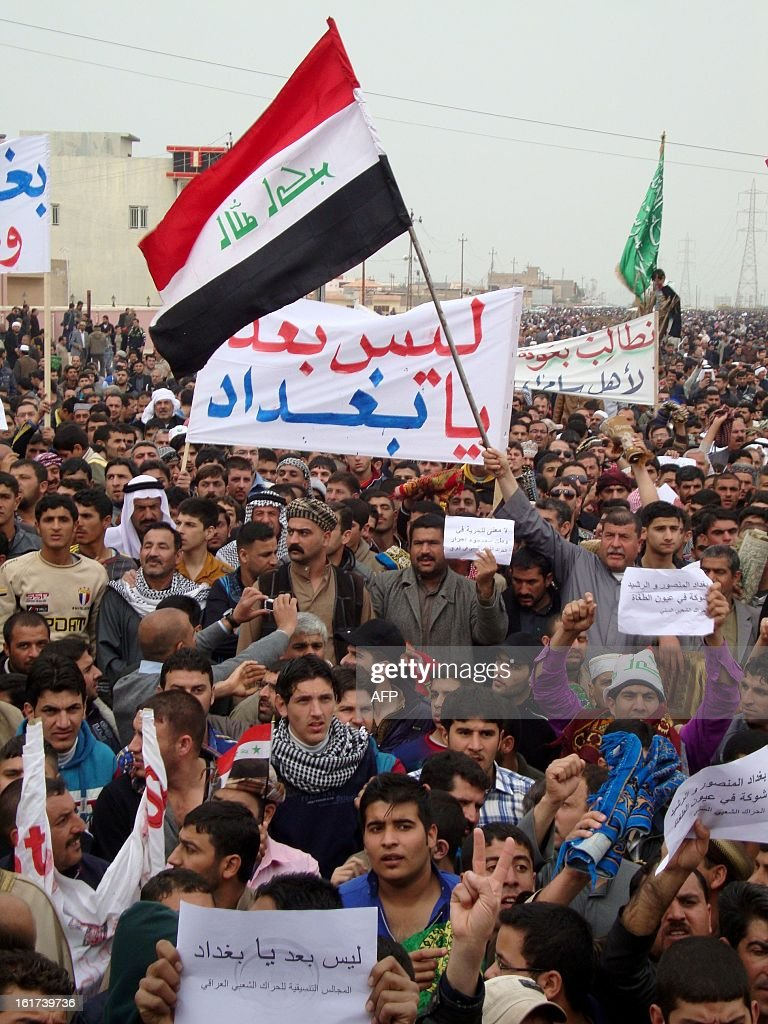 Iraqi's gather during a demonstration in the city of Samarra on January 15, 2013 demanding the ousting of Prime Minister Nuri al-Maliki. Thousands of people in Sunni-majority areas of Iraq called for the government's fall amid a spike in violence that has accompanied a political stalemate two months before provincial polls.