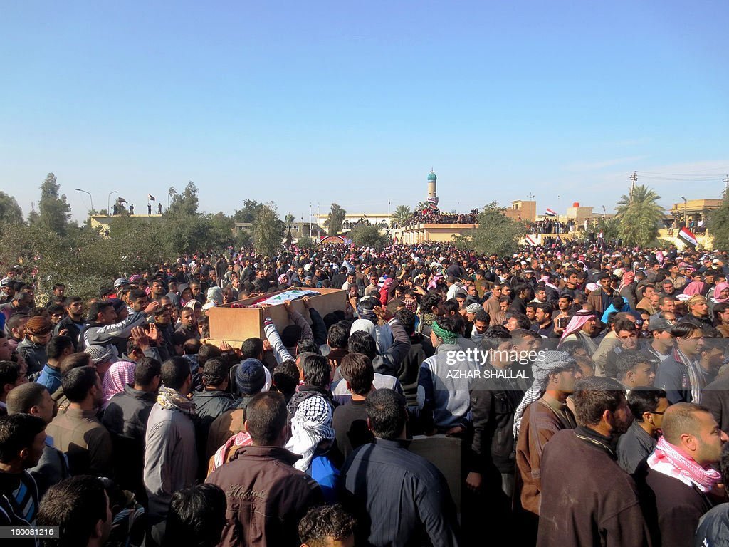 Iraqis gather during the funeral of one of six people killed by Iraqi troops the day before during a protest in the town of Fallujah, west of the Iraqi capital Baghdad on January 26, 2013. The deaths in the predominantly Sunni town were the first since protests began last month, and came as tens of thousands rallied in Sunni areas of the country, railing against alleged targeting of their minority by the Shiite-led authorities.