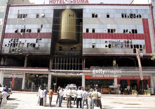 Iraqis gather outside the Soma Hotel in the northern city of Sulaimaniyah on July 16 2010 after a fire broke out late at night killing dozens of...