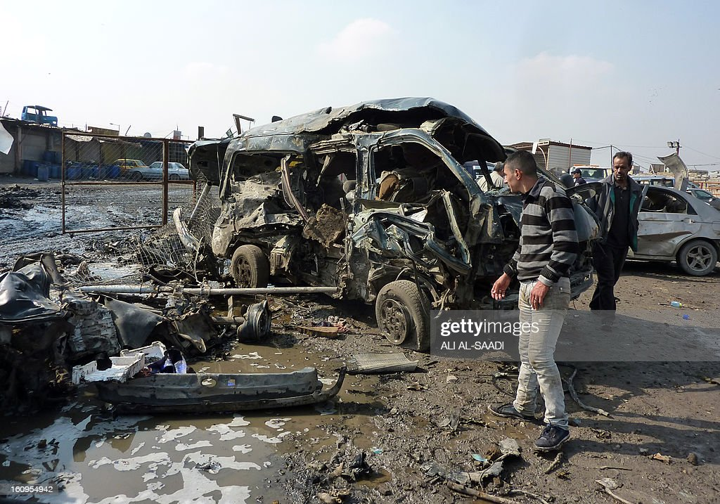 Iraqis inspect destroyed cars at the scene of an explosion at the bird market in the north Baghdad Shiite neighbourhood of Kadhimiyah on February 8, 2013. A spate of car bombs in Shiite areas of Iraq, including two blasts minutes apart at a popular bird market, killed at least 29 people, the latest in a spike in violence amid a political crisis. The attacks, which left nearly 70 others wounded, primarily targeted marketplaces that are often crowded on Fridays, the weekly holiday in Iraq, and took the death toll from a week of violence to more than 100. AFP PHOTO/ ALI AL-SAADI