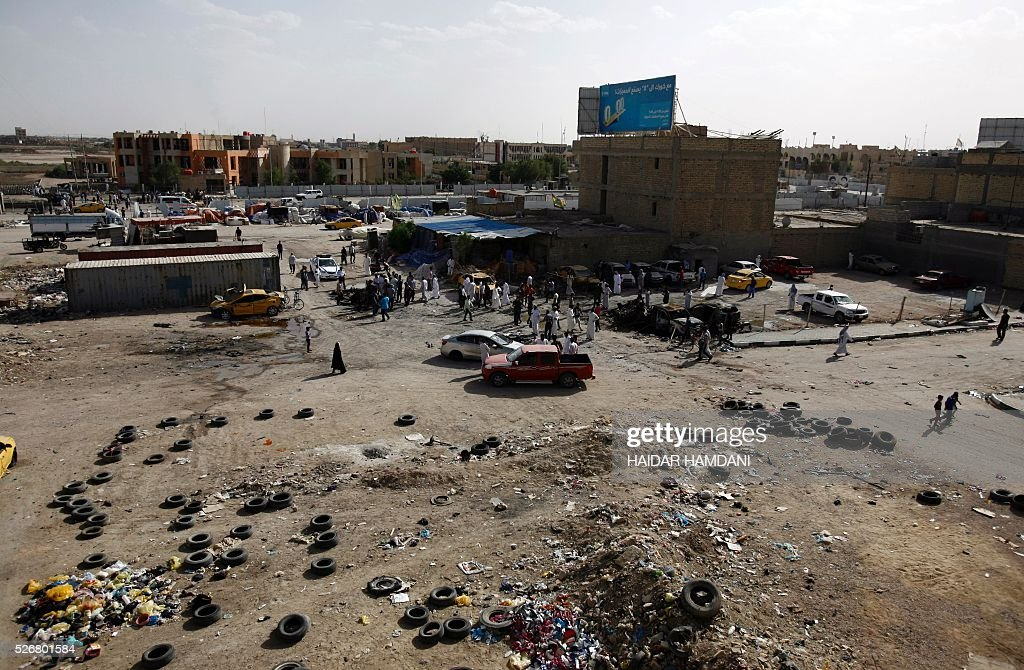 Iraqis look at the damage following a twin suicide bombing attack, claimed by the Islamic State (IS) group in the southern Iraqi city of Samawah, situated deep in Iraq's Shiite heartland, on May 1, 2016. HAMDANI