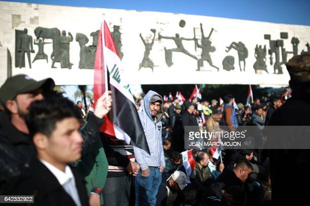 Iraqis mostly supporters of prominent cleric Moqtada Sadr gather on February 17 2017 in central Baghdad during a silent protest The rally was the...