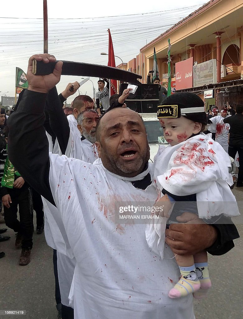 Iraqis perform Ashura mourning rituals to commemorate the death of Hussein, grandson of the Prophet Mohammed, in Kirkuk on November 25, 2012.