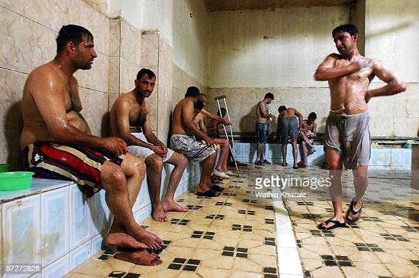 Iraqis relax and wash inside alMadina bathhouse in Sadr city neighborhood on April 7 2006 in Baghdad Iraq Arabic Bathhouses or 'Hammams'...