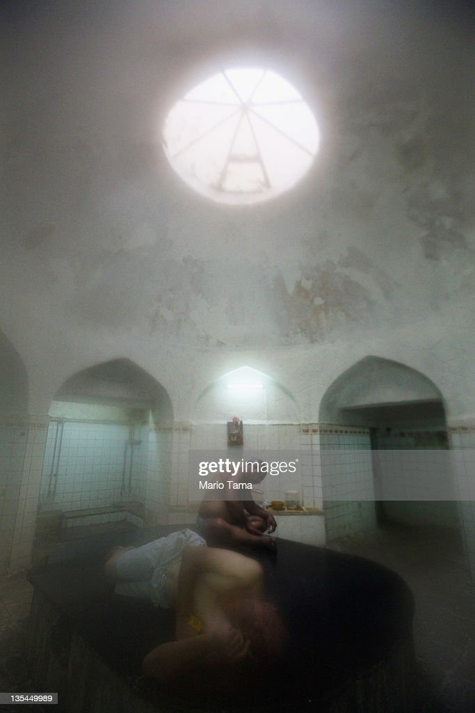 Iraqis relax in a hamam, or Turkish bath, on December 10, 2011 in Baghdad, Iraq. Some Iraqis visit the baths because they do not have hot water at home due to the continued electricity shortage while others visit to relax. Outside of the Kurdish north, most Iraqis receive just five hours per day of electricity. Iraq is transitioning nearly nine years after the 2003 U.S. invasion and subsequent occupation. American forces are now in the midst of the final stage of withdrawal from the war-torn country. At least 4,485 U.S. military personnel have died in service in Iraq. According to the Iraq Body Count, more than 100,000 Iraqi civilians have died from war-related violence.