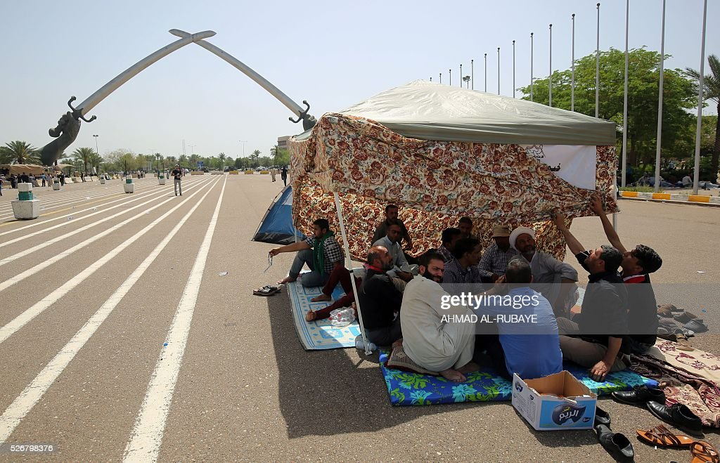 Iraqis rest near the 'Crossed Swords monument' in Baghdad's heavily fortified 'Green Zone' on May 1, 2016, the day after supporters of Shiite cleric Moqtada al-Sadr broke into the area after lawmakers again failed to approve new ministers. Thousands of wide-eyed Iraqis marvelled at the fountains, flowers and perfect lawns in the capital's Green Zone, a day after protesters breached the walls of the fortified area. The visitors were mostly protesters who broke in but also included Baghdadis taking the opportunity to see an area that was off-limits for so many years that it acquired almost mythical status in the psyche of ordinary citizens RUBAYE