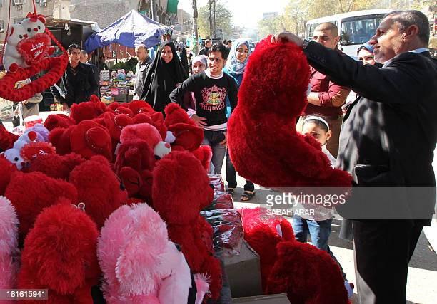 Iraqis shop on the eve of Saint Valentine's Day in Baghdad on February 13 2013 AFP PHOTO/SABAH ARAR