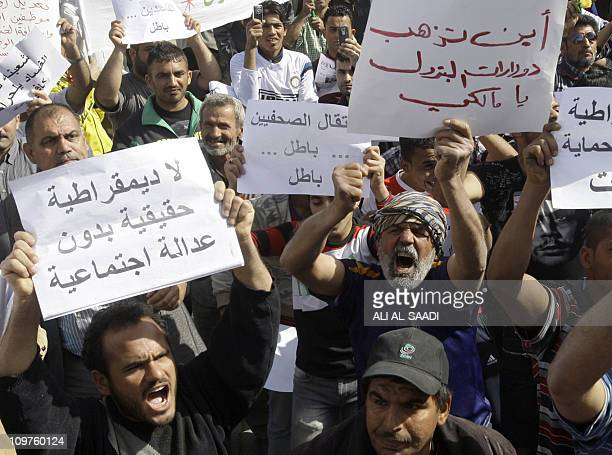 Iraqis some holding signs protest in the capital Baghdad over corruption unemployment and poor public services on March 4 2011 AFP PHOTO/ALI ALSAADI