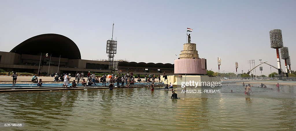 Iraqis swim in a pond in the parade grounds outside the parliament in Baghdad's heavily fortified 'Green Zone' on May 1, 2016, the day after supporters of Shiite cleric Moqtada al-Sadr broke into the area after lawmakers again failed to approve new ministers. Thousands of wide-eyed Iraqis marvelled at the fountains, flowers and perfect lawns in the capital's Green Zone, a day after protesters breached the walls of the fortified area. The visitors were mostly protesters who broke in but also included Baghdadis taking the opportunity to see an area that was off-limits for so many years that it acquired almost mythical status in the psyche of ordinary citizens RUBAYE