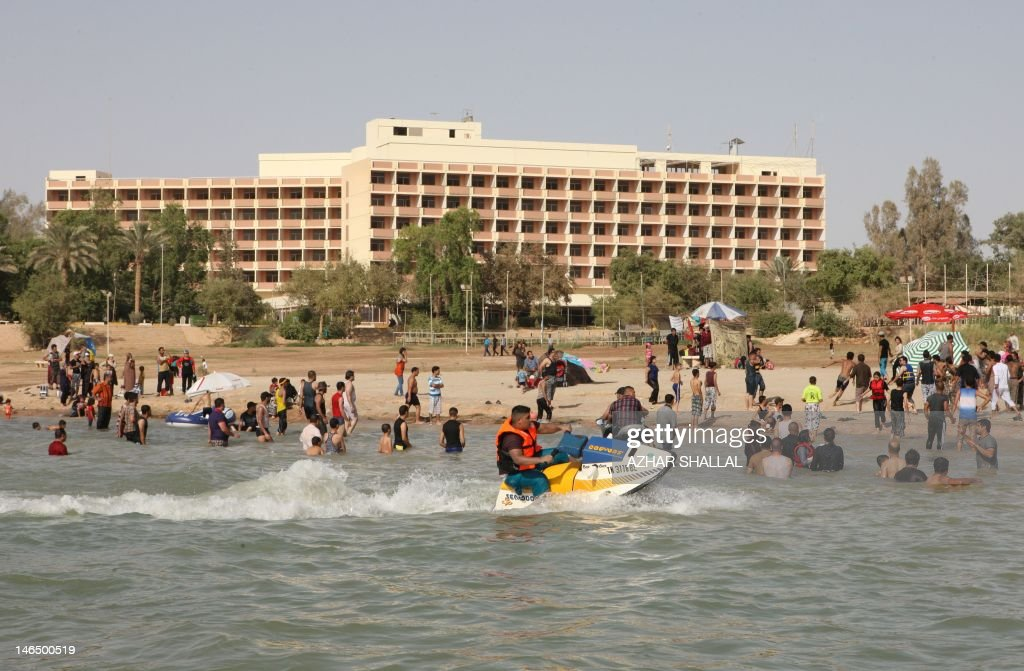 Iraqis swim in the lake of Habbaniyah, west of Baghdad, on June 17, 2012. The resort built around the lake in the late 1970s, situated between the cities of Ramadi and Fallujah, attracts holiday makers from within Iraq, mainly the capital Baghdad, seeking liesure and outdoor entertainment during the summer's soaring temperatures. AFP PHOTO/AZHAR SHALLAH