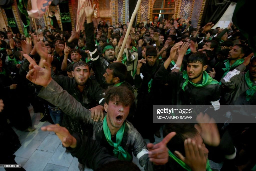 Iraqis take part in the Arbaeen religious festival which marks the 40th day after Ashura commemorating the seventh century killing of Prophet Mohammed's grandson, Imam Hussein, in the shrine city of Karbala, southwest of Iraq's capital Baghdad, on December 31, 2012. A wave of bombings and shootings killed 12 people as Iraq grappled with anti-government protests and simmering political crises ahead of major Shiite Muslim commemoration rituals.