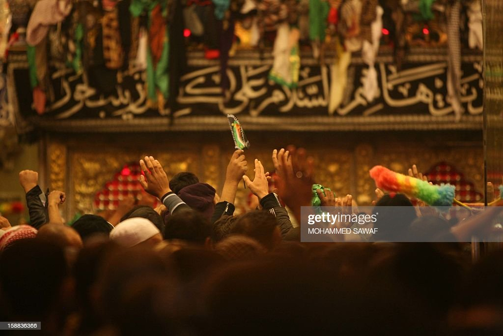 Iraqis take part in the Arbaeen religious festival which marks the 40th day after Ashura commemorating the seventh century killing of Prophet Mohammed's grandson, Imam Hussein, in the Imam Abbas shrine in the city of Karbala, southwest of Iraq's capital Baghdad, on December 31, 2012.