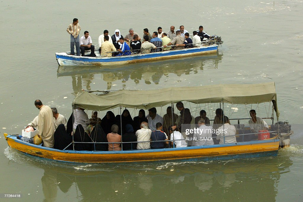 Iraqis use boats to cross the Tigris River in Baghdad 06 October 2007 Ferryman Hisham freely acknowledges that the poor and dangerous conditions of...